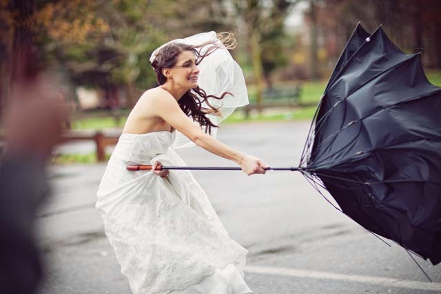 bride_and_umbrella_in_storm